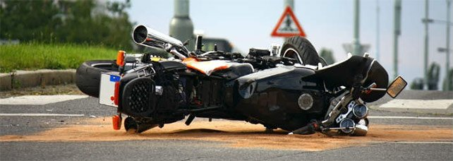 Motorcycle accident after driving too fast for road and weather conditions